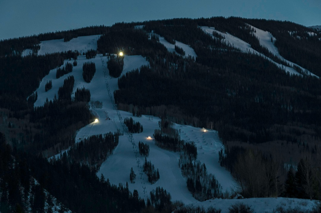 Grooming begins at twilight on the slopes along the Centennial Express Lift. Photo from our balcony.